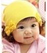 Детская шапочка с бантиками и хвостиками.