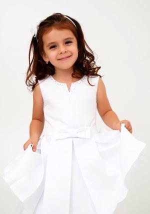 """Нарядное платье """"Лада"""" цвет белый.Платье украшает бант и пышная юбка. Платье сшито из перламутрового атласа-тафты и нижней юбки из фатина, хлопковая подкладка позволит комфортно чувствовать девочке в течение дня. Нарядное детское платье идеально для праздников, торжественных мероприятий, утренников в детском саду."""