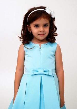 """Нарядное платье """"Лада"""" цвет ментоловый. Платье украшает бант и пышная юбка. Платье сшито из перламутрового атласа-тафты и нижней юбки из фатина, хлопковая подкладка позволит комфортно чувствовать девочке в течение дня. Нарядное детское платье идеально для праздников, торжественных мероприятий, утренников в детском саду."""