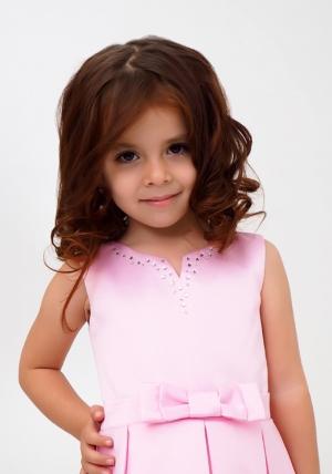 """Нарядное платье """"Лада"""" цвет розовый. Платье украшает бант и пышная юбка. Платье сшито из перламутрового атласа-тафты и нижней юбки из фатина, хлопковая подкладка позволит комфортно чувствовать девочке в течение дня. Нарядное детское платье идеально для праздников, торжественных мероприятий, утренников в детском саду."""