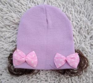 Детская шапочка с бантиками и хвостиками. Очень нарядная шапочка для девочек с 0 до 2 лет. Очень хорошо тянется. Ваша малышка будет самой привлекательной в такой шапочке.