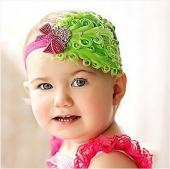 Детская повязка с перьями ярко-зеленого цвета.