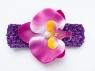 Цветок орхидея фиолетового цвета на повязке в сеточку.