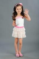 Сарафан с пышной юбочкой молочно-розового цвета.