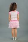 Нарядная юбка с оборками розового цвета.