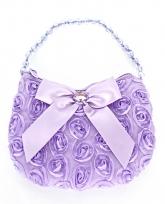 Маленькая сиреневая сумочка с розочками и атласным бантиком.