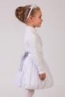 Нарядная белая юбка с розочками на поясе и большим бантом.