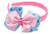 Ярко-розовый ободок для волос с бантиком в горох.
