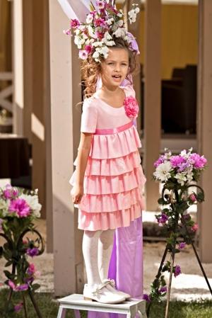 """Нарядное платье """"Лидия"""" розового цвета.Стильное и модное платье для девочек с укороченной талией и юбкой c оборками. Украшает платье красивый и нежный цветок розового цвета Данное платье из атласа. Сзади застегивается на пуговку."""