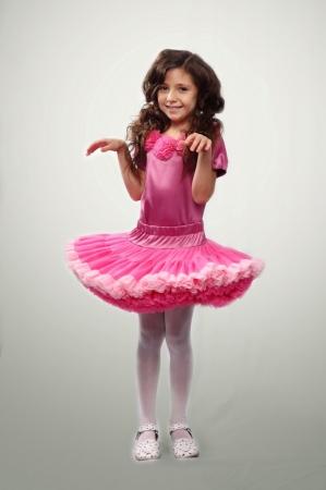 Пышная ярко-розовая юбка с цветом брусникис оборками из нежной мягкой сетки. Эластичный пояс и кокетка из атласа, оборки из сетки-стрейча.Красивая юбочка для девочек из мягкой сетки-шифона.