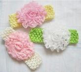 Красивая повязка в сеточку с цветком.