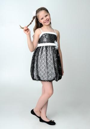 """Нарядное платье """"Кристи"""" бело-черного цвета с болеро.Лиф платья украшен паетками, юбка из гипюра, пышная в форме балона. Объем изделия регулируется на спине вшитой резинкой. Платье украшают цветок на талии и атласный пояс. Красивый наряд для настоящих модниц."""