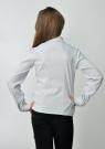 Детская блузка бело-серого цвета с длинным рукавом и манишкой.