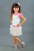 Нарядная юбка с оборками молочно-розового цвета.