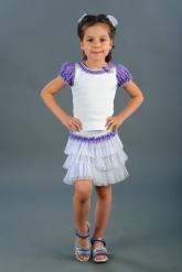 Нарядная юбка с оборками бело-сиреневого цвета.