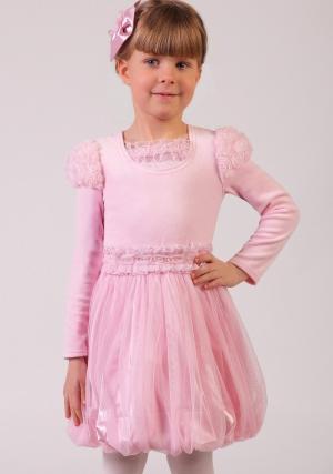 """Нарядная блузка розового цвета из велюра с длинным рукавом """"фонариком"""".Горловина блузки дополнена трикотажной вставкой, отделанной нежными рюшами и ажурными розочками из сеточки со стразинками в серединке.Мягкий материал не только украсит наряд маленькой принцессы, но и согреет её в прохладное время.Немного маломерит!"""